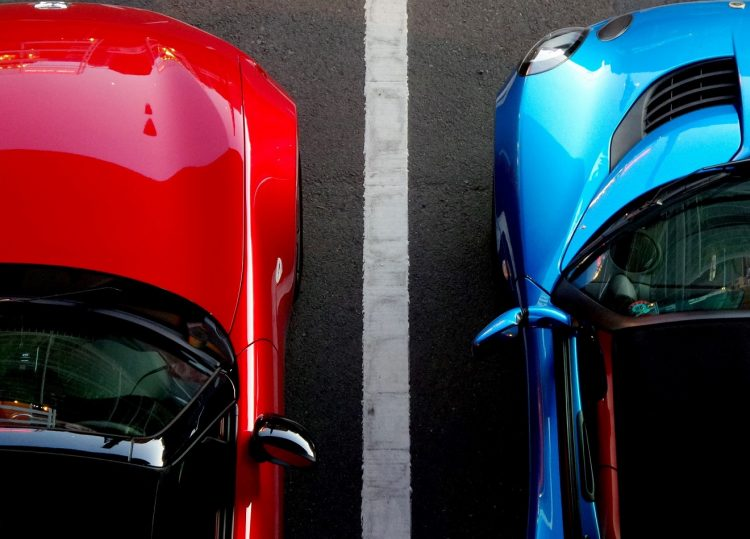 Two cars parked side by side